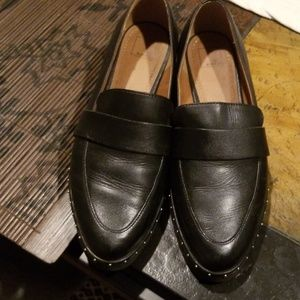 Black loafers with small silver beads